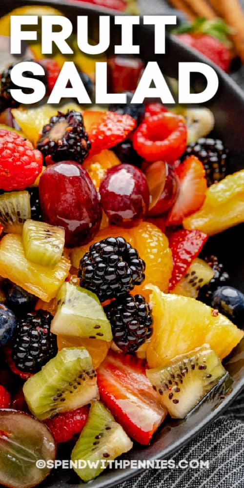 close up of fruit salad with text