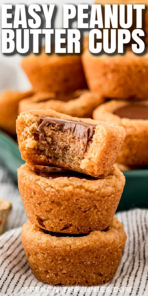 close up of Peanut Butter Cookies Cups in a stack with a plate full in the back and writing