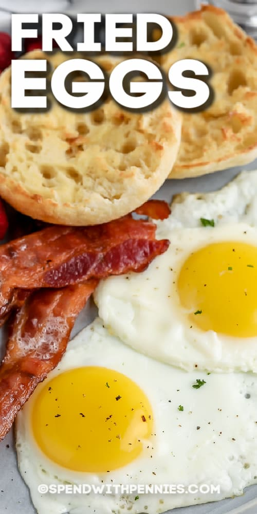 two fried eggs with bacon and english muffins with text