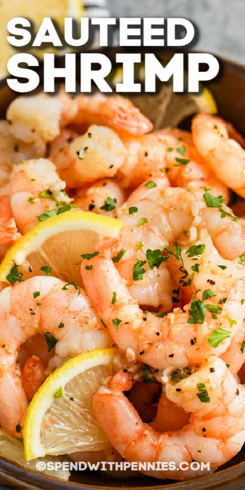 Sauteed Shrimp in a bowl garnished with lemon and parsley