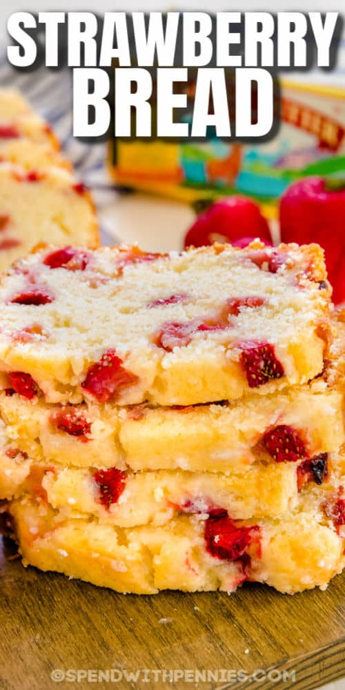 Strawberry Bread on a wooden board with a title