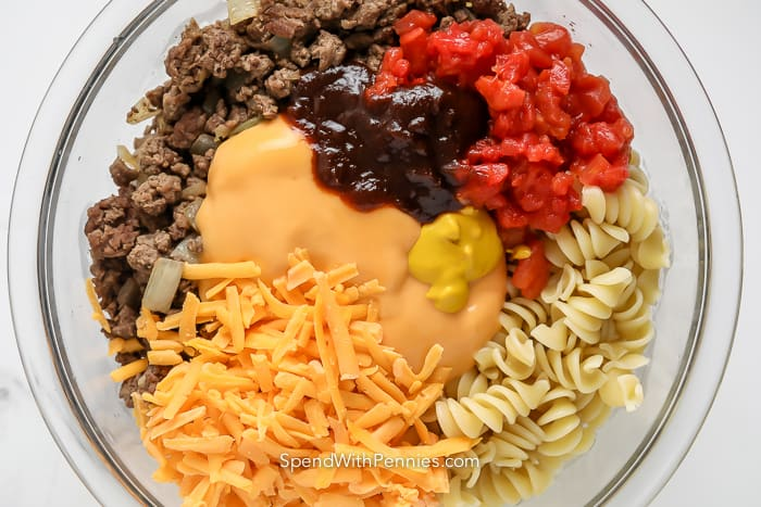 ingredients to make cheeseburger casserole in a bowl