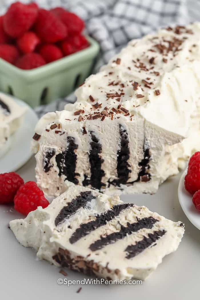 Chocolate Icebox Cake with slice taken off with raspberries