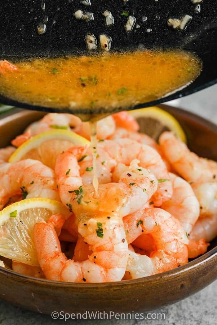 Sauteed Shrimp with sauce being poured on