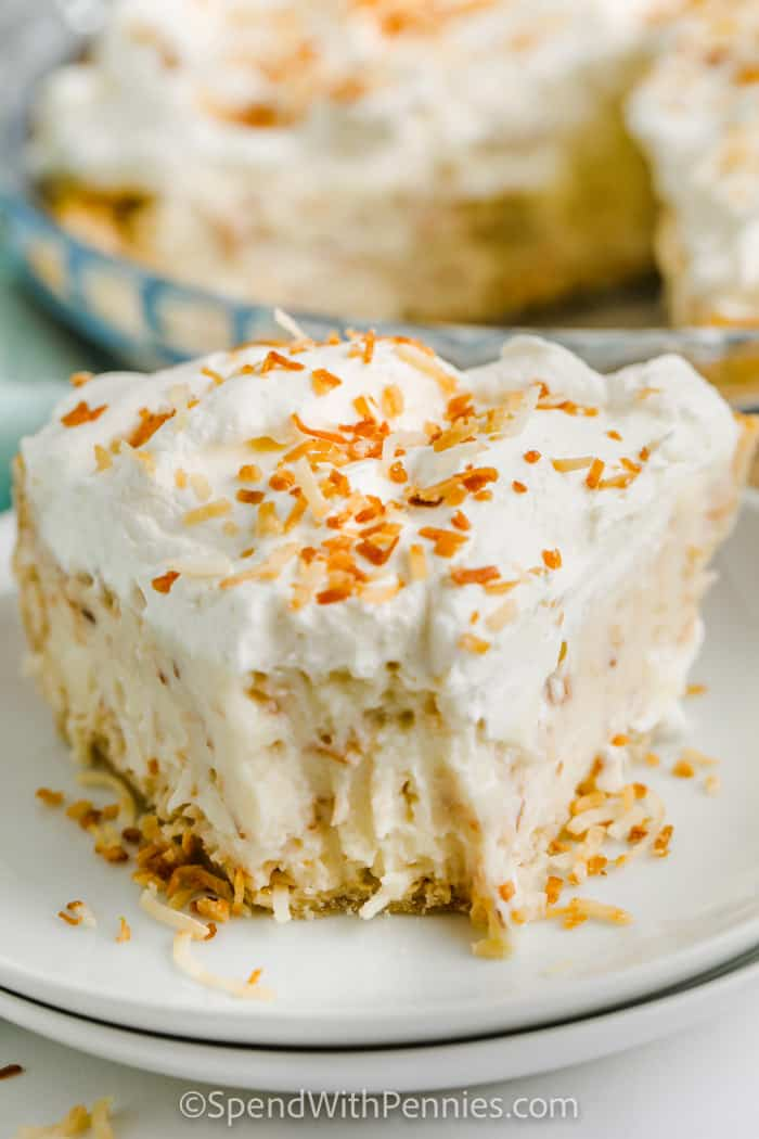 Piece of Ultimate Coconut Cream Pie on a white plate