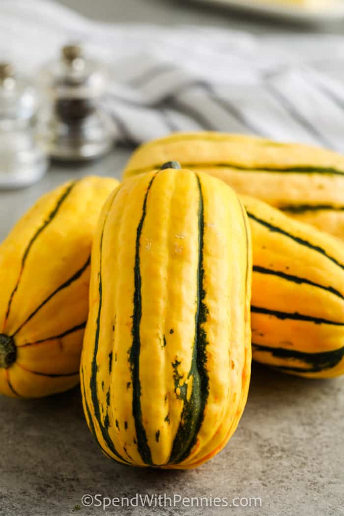 squash on a table to show What is Delicata Squash