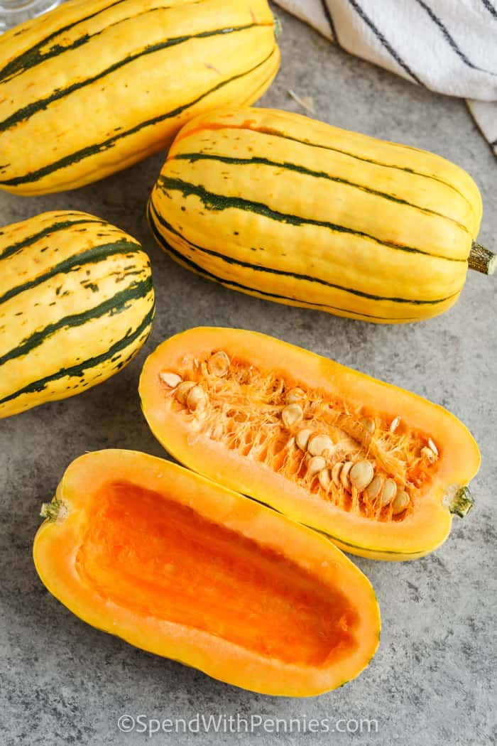 squash with one cut in half to show What is Delicata Squash