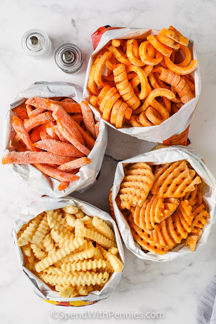 four bags of different types of French fries to make Air Fryer Frozen French Fries