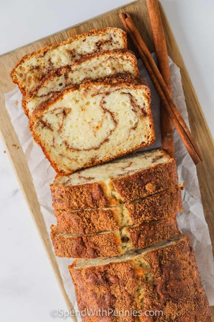 easy Cinnamon Bread on a cutting board sliced