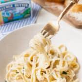 bowl with fork full of Fettuccine Alfredo