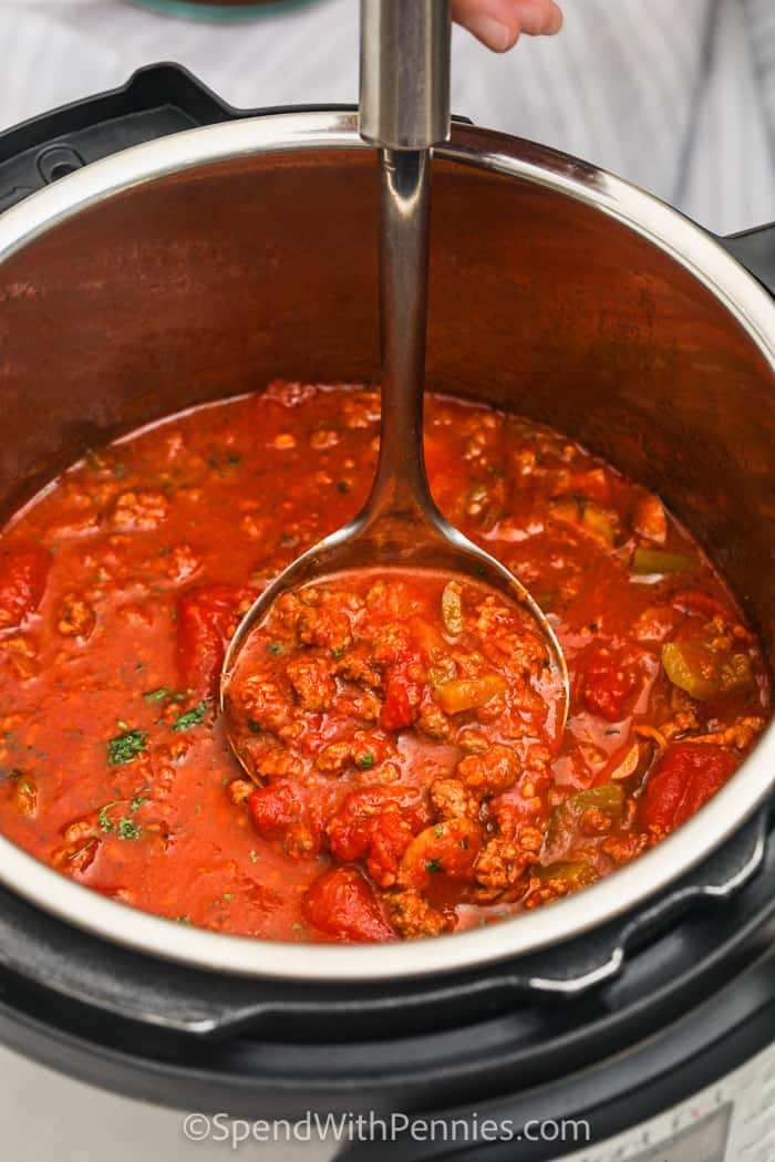 cooked Instant Pot Pasta Sauce in the instant pot with a paddle