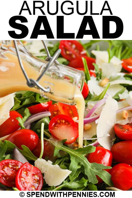 close up of Easy Arugula Salad with salad dressing and a title