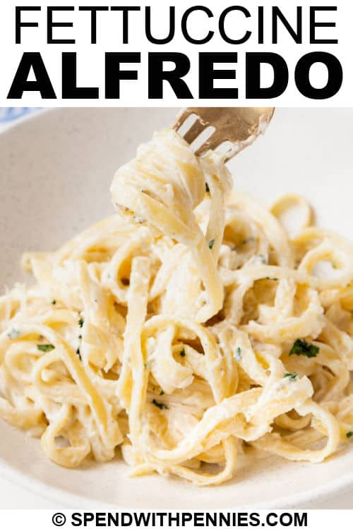close up of plated Fettuccine Alfredo with writing