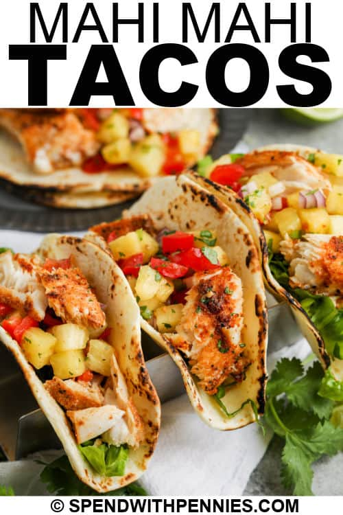 plated Mahi Mahi Tacos with writing