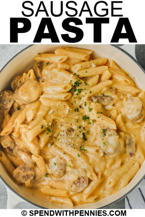 cooked Stove Top 3 Cheese Pasta with Sausage in the pot with garnish and writing