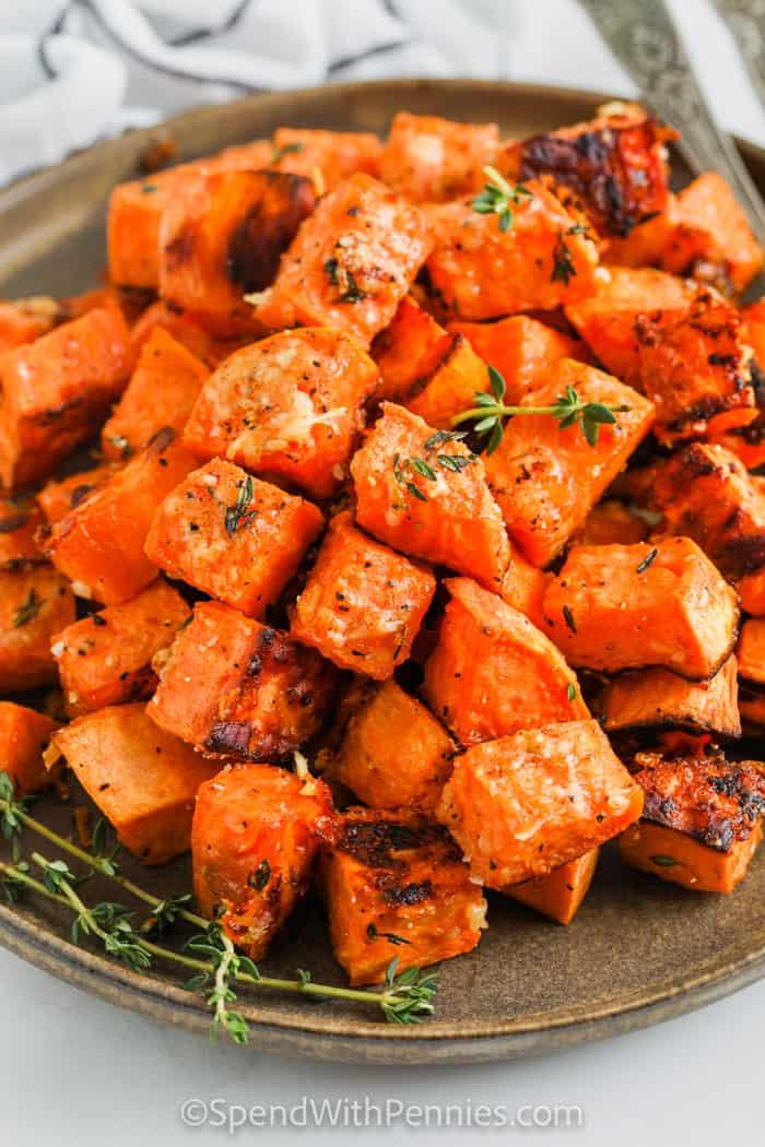 plate full of Parmesan Sweet Potatoes