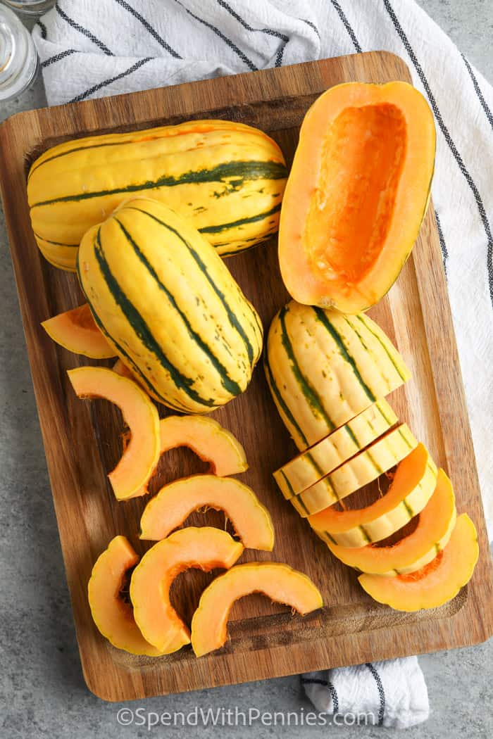 process of cutting up squash to make Roasted Delicata Squash