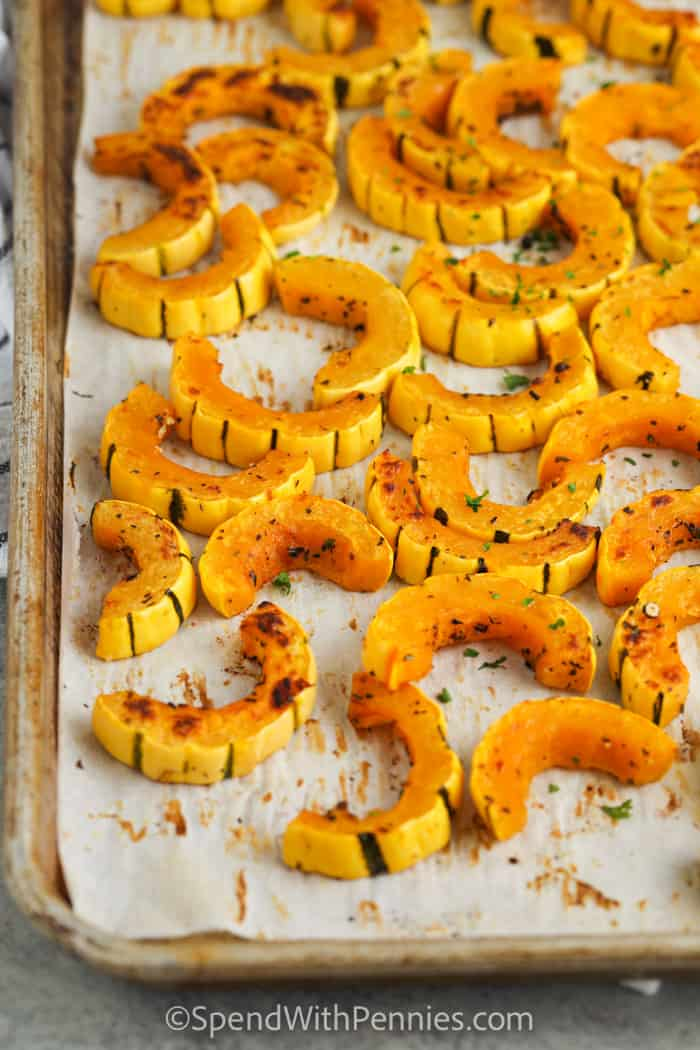 cooked Roasted Delicata Squash on a baking sheet