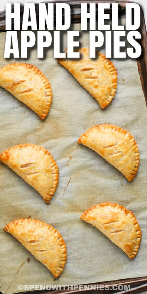 cooked Apple Hand Pies on a baking sheet with a title