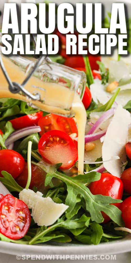 pouring dressing over Easy Arugula Salad with writing