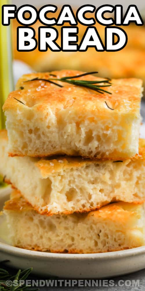 pile of Focaccia Bread on a white plate with writing