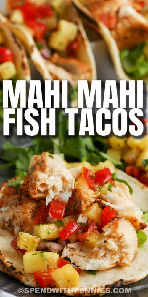 open faced Mahi Mahi Tacos with plated tacos in the back and a title