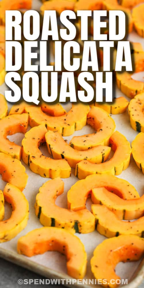 Roasted Delicata Squash on a baking sheet before cooking with a title