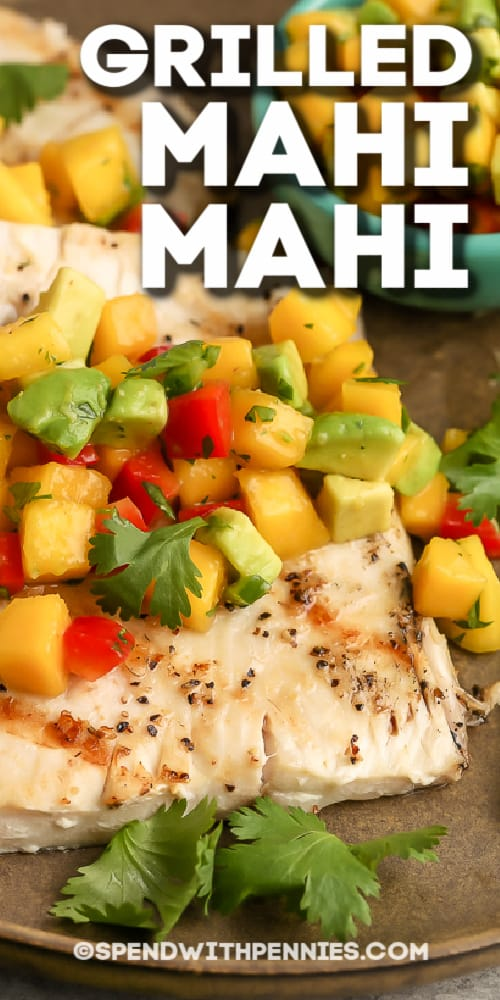Grilled Mahi Mahi topped with mango salsa with text