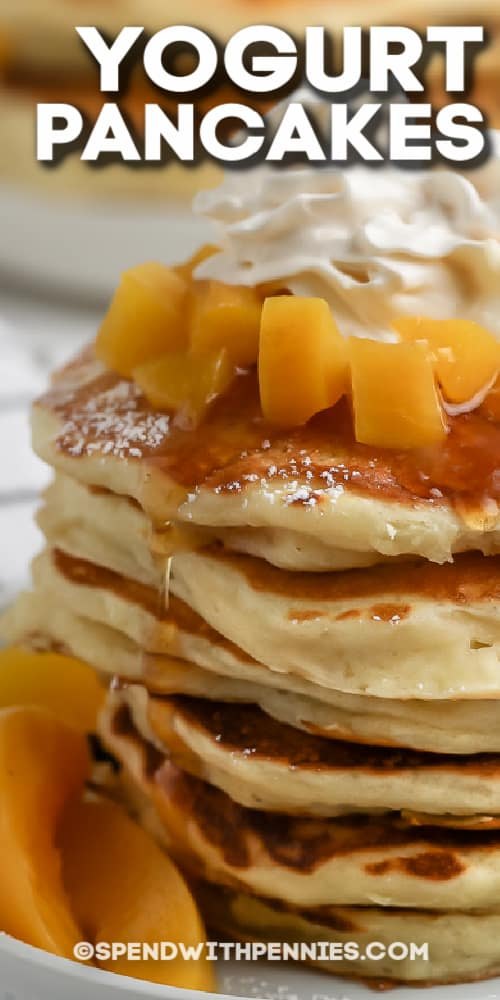 close up of stack of yogurt pancakes topped with whipped cream with text