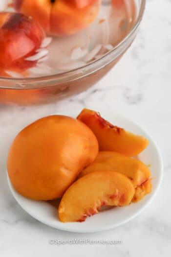 a sliced peach on a plate