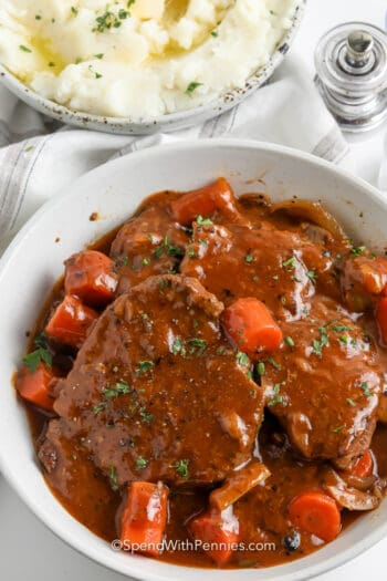 Swiss Steaks covered in gravy in a bowl