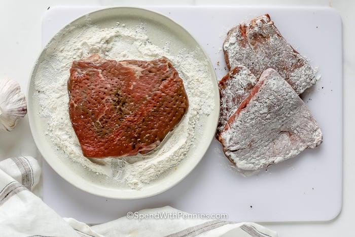steak on a plate of flour