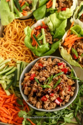 top view of Turkey Lettuce Wraps on a pan with filling and toppings