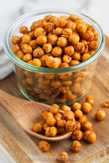 jar of Spiced Air Fryer Chick Peas with a wooden spoon beside it