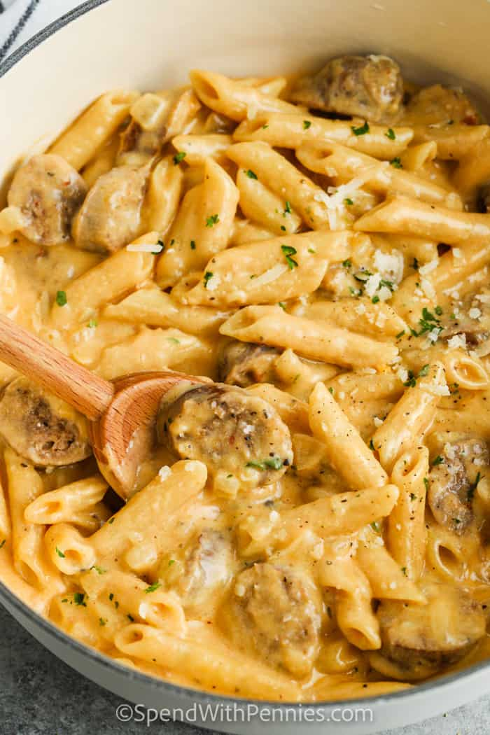 Stove Top 3 Cheese Pasta with Sausage with a wooden spoon