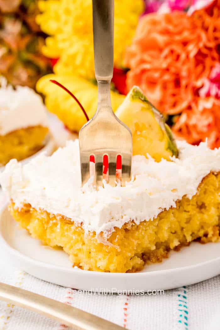 close up of Pina Colada Cake on a fork