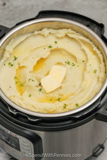 Instant Pot Mashed Potatoes in the pot with butter on top