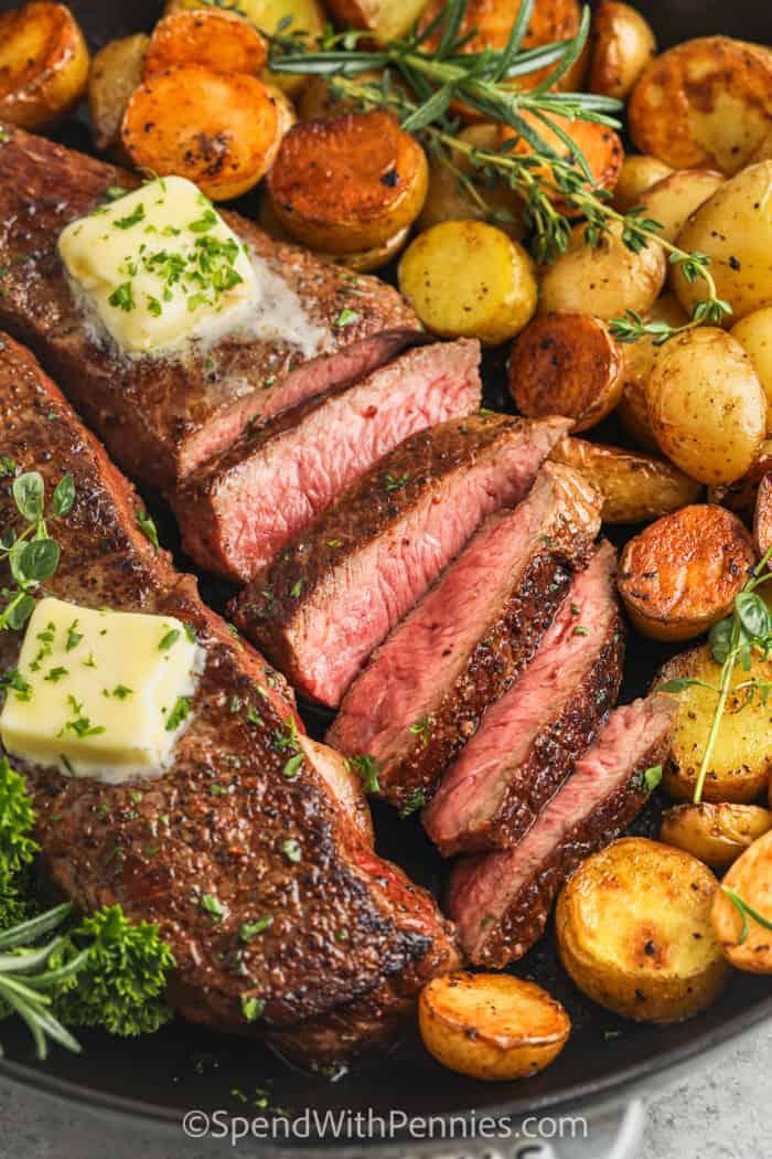 sliced Rosemary Garlic Steak & Potatoes in a pan
