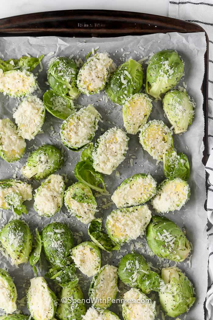 brussels sprouts on a pan coated in parmesan cheese