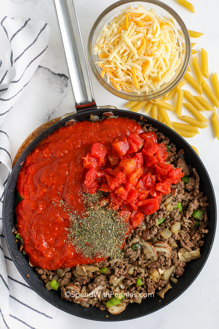 sauce ingredients for pizza casserole in a pan
