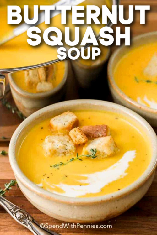 A serving of butternut squash soup topped with croutons with text