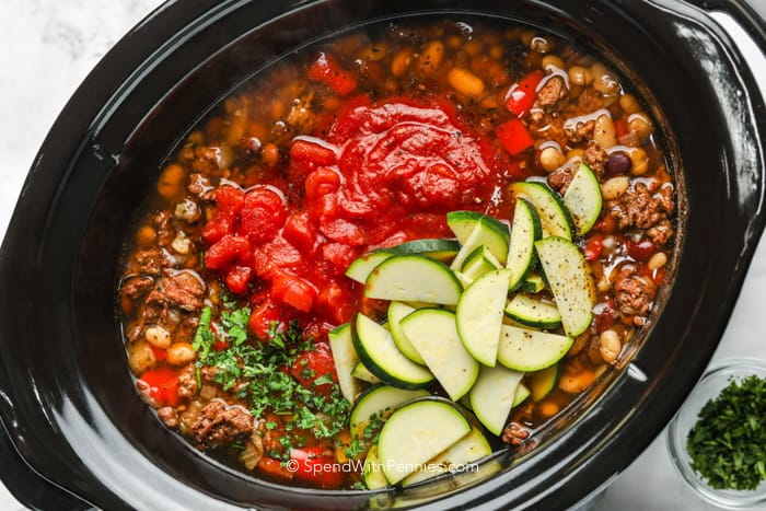 Adding vegetables to cooked beans in a crock pot
