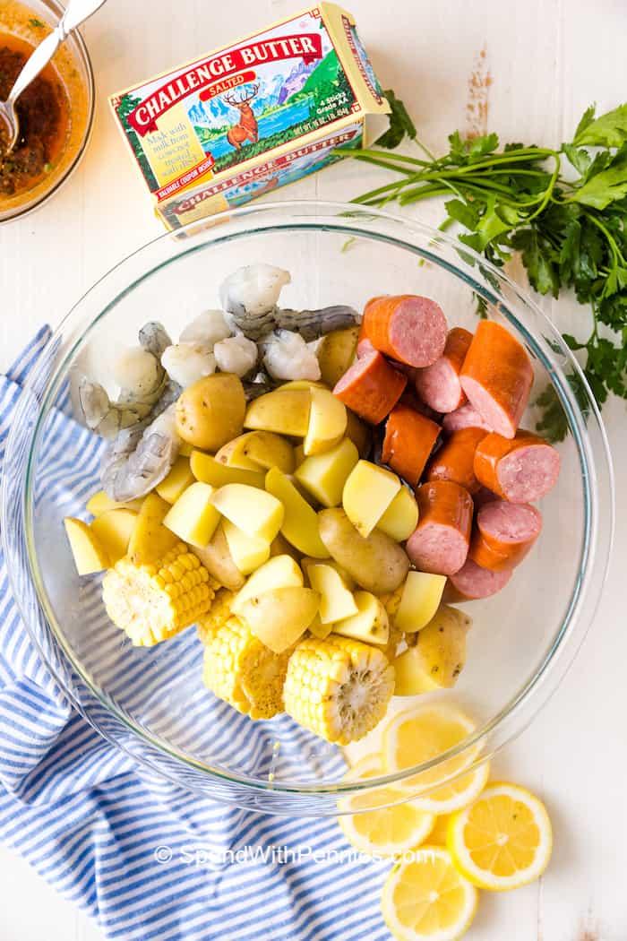 Ingredients for a shrimp boil in a bowl
